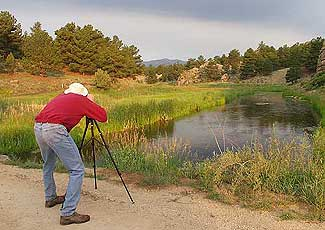 A Photographer Shoots at a Creek